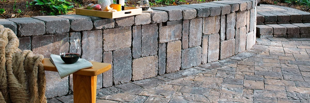 Why Pavers - Beauty - Stone Pavers Used to Create a Retaining Wall on a Back Porch