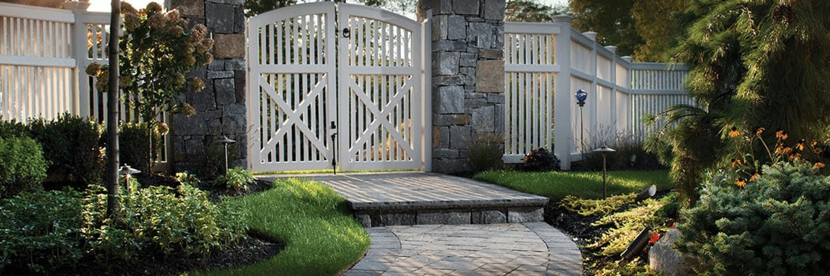 Why Pavers - Beauty - Stone Paver Pathway leading to a Front Yard Gate