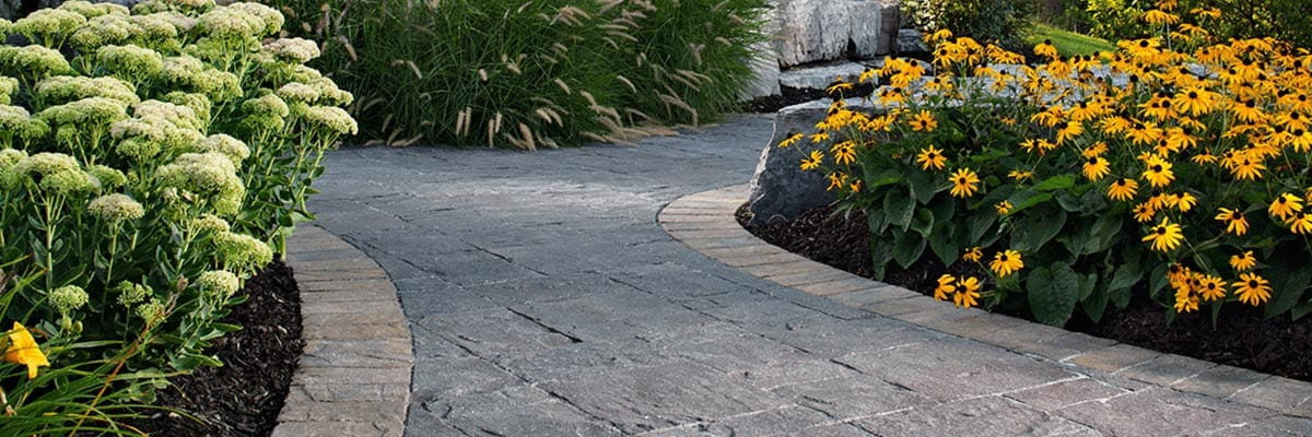 Benefits - Paving Stone Path in Yard Surrounded By Flowers