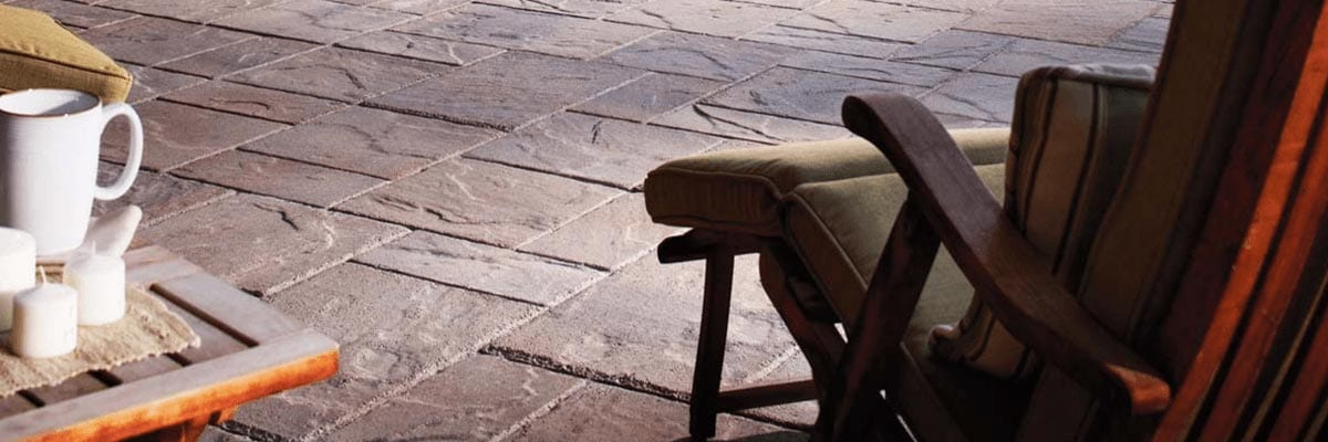 Benefits - Lounge Chair on Patio covered with stone pavers