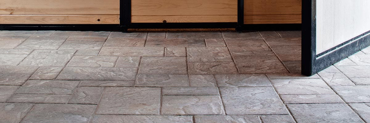 Benefits - Wood Door Opening With Stone Pavers on Ground