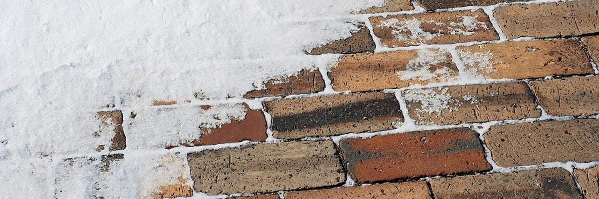 Benefits - Snow covering brick pavers in winter