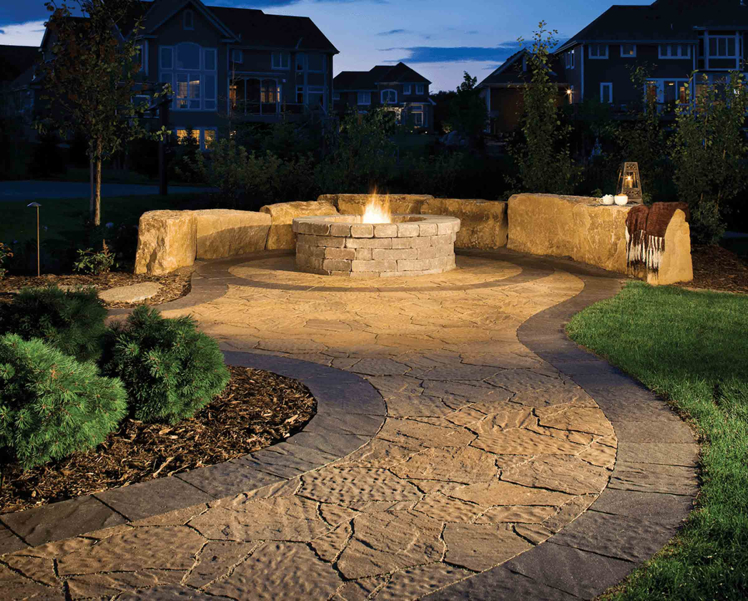 Why Pavers - Stone Pavers used to create a path leading up to a stone paver fire pit.