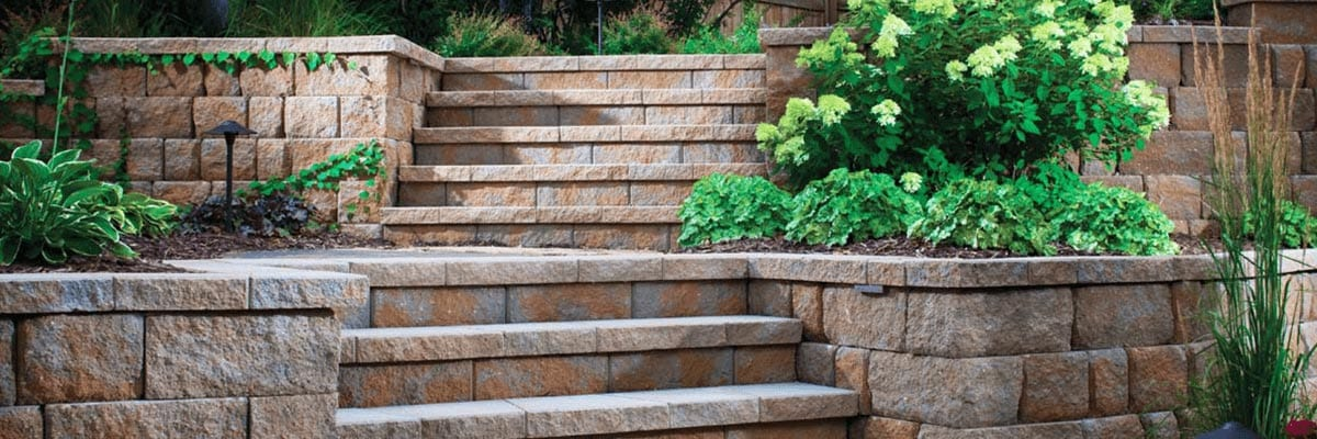 Pavers Vs. Concrete - Stone pavers and retaining walls are used for a stairway