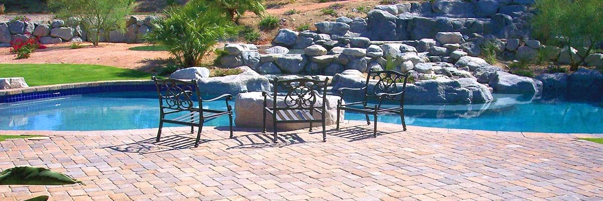 Installation - Stone Pavers Used for a Patio and to Create a Barrier Around a Plant