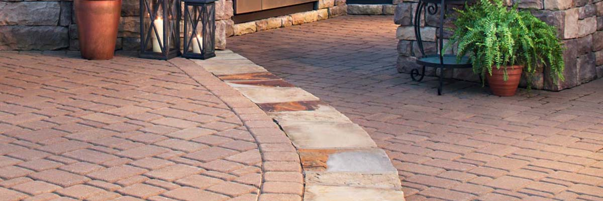 Installation - Stone Pavers Used to Create a Step in a Backyard