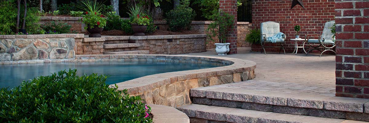 Installation   Stone Pavers Used For A Pool Deck And Brick Pavers Used For  A Retaining
