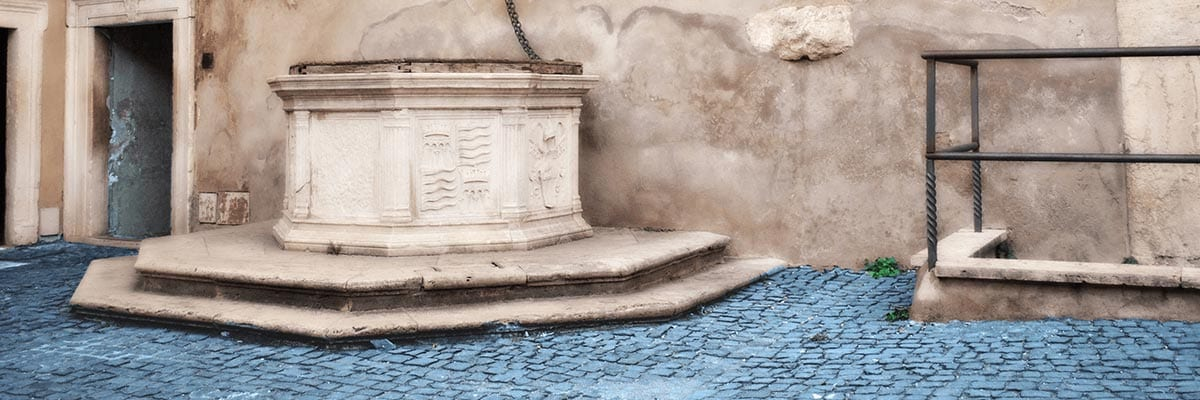 Pavers Vs. Concrete - Old and Durable Paving Stones Centered Around a Well in Rome