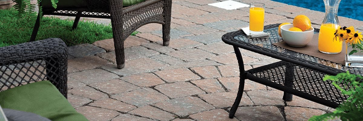Pavers Vs. Concrete - Pavers are used to create a relaxing environment by the pool