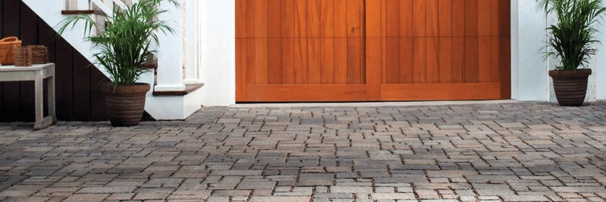 Why Pavers - Strength - Stone Pavers Leading to a Wood Garage Door
