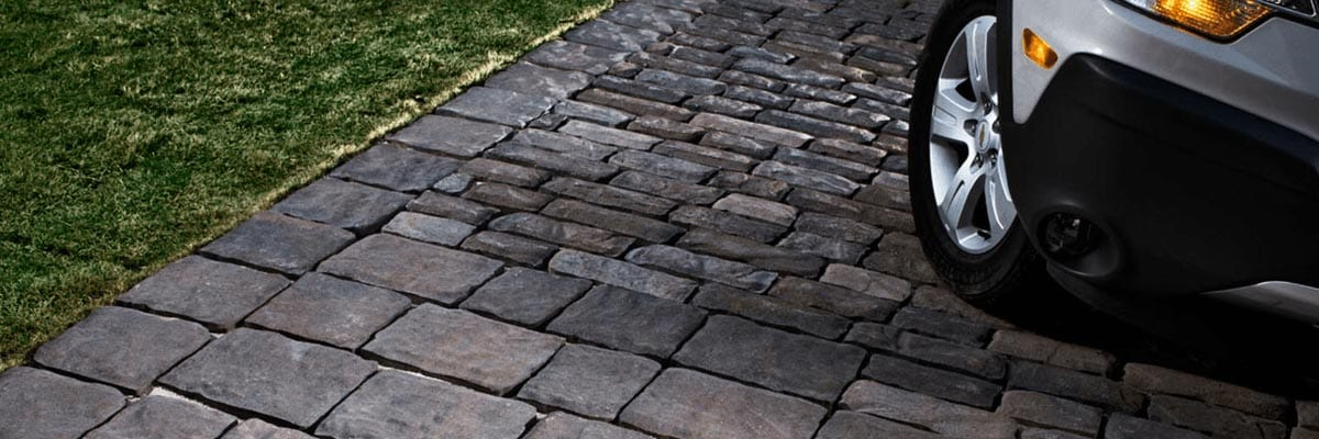Why Pavers - Strength - Stone Pavers being driven on by a SUV