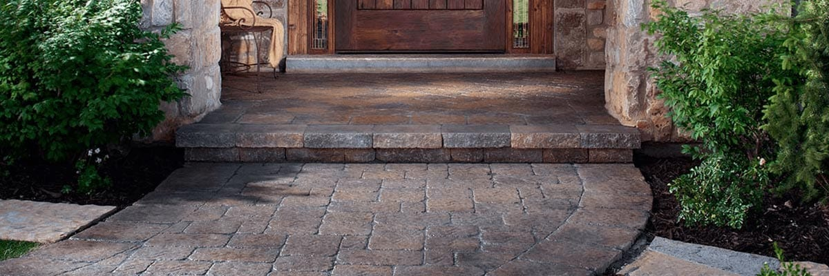 Pavers Vs. Concrete - Pavers are used to create a beautiful entryway for a home.